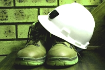 builder's hard hat and boots